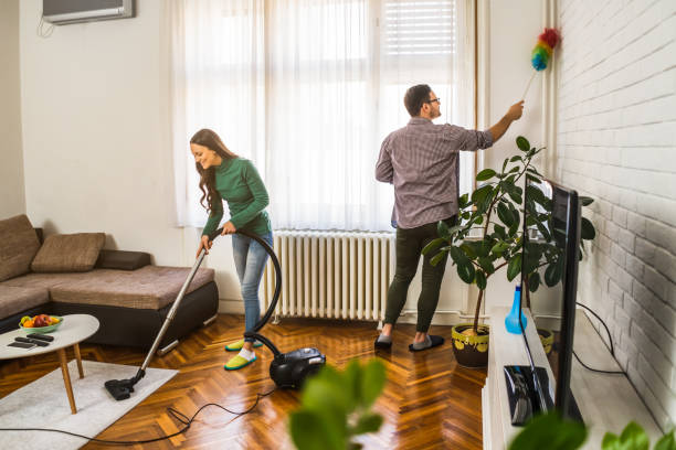 cleaning their apartment.